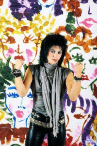 Target, Tumblr, and Blog: algemesi11:    ca. 1985 Musician Joan Jett makes fists while standing in front of a backdrop painted with women's faces. Image by © Fabio Nosotti/ Corbis