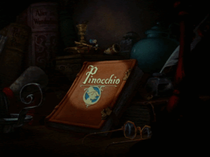 In the opening shot in Disney's Pinocchio (1940) there are two books which read Alice in Wonderland and Peter Pan on their spines. These are also famous stories which Disney have adapted to screen.: Alle  Wen  Tinocchio In the opening shot in Disney's Pinocchio (1940) there are two books which read Alice in Wonderland and Peter Pan on their spines. These are also famous stories which Disney have adapted to screen.