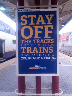 You aint a train: AMAR 1-800-233-9942  STAY  OFF  THE TRACKS  THEY ARE ONLY FOR  TRAINS  IF YOU CAN READ THIS  YOURE NOT A TRAIN  3004 You aint a train