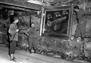 Soldiers, American, and Salt: American Soldiers look at artwork looted by Nazis in a salt mine. (1945)