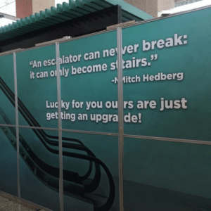 """loloftheday:  The tallest building in Dallas is a Mitch Hedberg fan.: """"An esc elator can ne ver break:  -NİHitch Hedberg  Lucky for you ou rs are just  S 35  it can o ly become si tairs.  get ting an upgra de loloftheday:  The tallest building in Dallas is a Mitch Hedberg fan."""