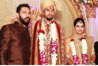 Memes, 🤖, and Yuvraj Singh: An Yuvraj Singh with the newly wed couple Mr. and Mrs. Ishant Sharma