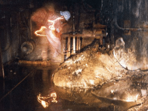 Apparently, Definitely, and Run: angrynerdyblogger: sixpenceee:  ONE OF THE MOST DANGEROUS PICTURES TAKEN The above picture you see is off the elephant's foot, a radioactive mass. It's from the Chernobyl nuclear disaster.  These are the effects: After just 30 seconds of exposure, dizziness and fatigue will find you a week later. Two minutes of exposure and your cells will begin to hemorrhage (ruptured blood vessels); four minutes: vomiting, diarrhea, and fever. 300 seconds and you have two days to live.  ANOTHER DEADLY PLACE SOURCE  MORE INFORMATION  The coolest thing about this photo is definitely the radiation damage. Look at the bright squiggles, and the way the man seems to be in two places at once. This is because even as the photo is being taken, the radiation is causing severe damage to the camera. According to another source, the man in the photograph and the cameraman are now dead. Apparently, the radiation would have been too high for them to live more than a few years after this, even if they had just run in, snapped the photo, and ran out again. If they spent more than a few seconds here, it's possible they could have died even quicker.