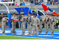The Air Force Academy Color Guard unfurled the United States flag prior to the football game between the Navy Midshipmen and the Air Force Falcons at Falcon Stadium, United States Air Force Academy. Air Force defeated Navy 35-7.: AOL  OFFICIA LOGIS  E GRAD  AOG  st The Air Force Academy Color Guard unfurled the United States flag prior to the football game between the Navy Midshipmen and the Air Force Falcons at Falcon Stadium, United States Air Force Academy. Air Force defeated Navy 35-7.