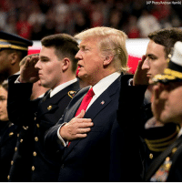 President DonaldTrump stood with servicemembers during the national anthem at the College Football Playoff National Championship game on Monday.: (AP Photo/Andrew Harnik) President DonaldTrump stood with servicemembers during the national anthem at the College Football Playoff National Championship game on Monday.