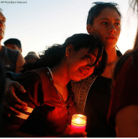 Hundreds of people gathered for a vigil in Parkland, Florida for the victims of Wednesday's deadly school shooting.: (AP Photo/Brynn Anderson) Hundreds of people gathered for a vigil in Parkland, Florida for the victims of Wednesday's deadly school shooting.
