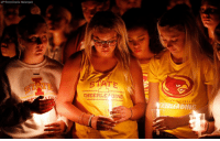 Iowa State University students participate in a candlelight vigil for Celia Barquin Arozamena, a student and star golfer who was found dead in a pond near the campus.: (AP Photo/Charlie Neibergall)  CHEERLE DING  TA  IVERS  HERLEADING Iowa State University students participate in a candlelight vigil for Celia Barquin Arozamena, a student and star golfer who was found dead in a pond near the campus.