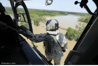 U.S. Army National Guard Staff Sgt. Drew Gleason looks for flood victims in the aftermath of Hurricane Harvey while flying over Liberty, Texas, on Friday.: AP Photo David J Phillip) U.S. Army National Guard Staff Sgt. Drew Gleason looks for flood victims in the aftermath of Hurricane Harvey while flying over Liberty, Texas, on Friday.