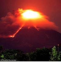 Memes, Philippines, and Volcano: AP Photo/Earl Recamunda. Lava cascades down the slopes of Mayon volcano in the Albay province, in the Philippines. More than 9,000 people have evacuated the area around the Philippines' most active volcano as lava flowed down its crater Monday in a gentle eruption that scientists warned could turn explosive.