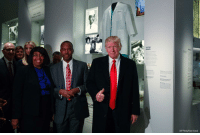 President DonaldTrump, Dr. BenCarson and his wife Candy Carson took a tour of the National Museum of African American History and Culture. They stopped to look at an exhibit on Carson, who is now the nominee for Housing and Urban Development Secretary.: AP Photo/Evan Vucci)  CA President DonaldTrump, Dr. BenCarson and his wife Candy Carson took a tour of the National Museum of African American History and Culture. They stopped to look at an exhibit on Carson, who is now the nominee for Housing and Urban Development Secretary.