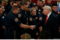 Fire, Memes, and Beach: AP Photo/Evan Vuccil While spending the holidays at Mar-A-Lago, President Trump met with firefighters at West Palm Beach Fire Rescue and thanked them for their service.