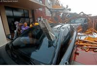 A hotel canopy in Panama City, FL collapsed as HurricaneMichael swept through Wednesday, and sent debris smashing through this windshield.: AP Photo/Gerald Herbert A hotel canopy in Panama City, FL collapsed as HurricaneMichael swept through Wednesday, and sent debris smashing through this windshield.