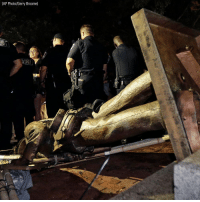 "Memes, Police, and Monday: (AP Photo/Gerry Broome) Police stood guard after the confederate statue known as ""Silent Sam"" was toppled by protesters at @uncchapelhill on Monday."