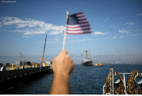 PatMcClurg holds a flag as he waits for his son, aboard the USS Dewey as it arrives to Naval Base San Diego on Monday in SanDiego. Dewey, an Arleigh Burke-class guided-missile destroyer, returned Monday after a four-month deployment to the Western Pacific. ProudAmerican: AP Photo Gregory But PatMcClurg holds a flag as he waits for his son, aboard the USS Dewey as it arrives to Naval Base San Diego on Monday in SanDiego. Dewey, an Arleigh Burke-class guided-missile destroyer, returned Monday after a four-month deployment to the Western Pacific. ProudAmerican