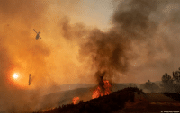 Fire, Memes, and California: AP Photo/Josh Edelson A helicopter drops water on a burning hillside during the Ranch Fire in Clearlake Oaks, California, on Sunday.