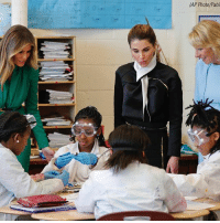 First Lady MelaniaTrump, Queen Rania of Jordan, and Education Secretary Betsy DeVos talk with students during a science class at the Excel Academy Public Charter school in Washington. Mrs. Trump made her first foray in the neighborhoods of the city she says will become her adopted hometown with a visit to a charter school for girls, to highlight the Trump administration's focus on school choice.: (AP Photo/Pabl First Lady MelaniaTrump, Queen Rania of Jordan, and Education Secretary Betsy DeVos talk with students during a science class at the Excel Academy Public Charter school in Washington. Mrs. Trump made her first foray in the neighborhoods of the city she says will become her adopted hometown with a visit to a charter school for girls, to highlight the Trump administration's focus on school choice.
