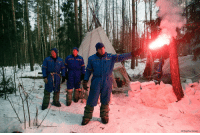 NASA astronaut Andrew J. Feustel holds a flare as Russian Cosmonauts Oleg Artemyev and Sergej Prokopyev stand near the hut which they built during a three-day winter training in a forest at Russian Space Training Center in Star City, outside Moscow, Russia, Wednesday, Feb. 8, 2017. The three are being trained for a future mission to the ISS.: (AP Photo/Pavel Golovkin NASA astronaut Andrew J. Feustel holds a flare as Russian Cosmonauts Oleg Artemyev and Sergej Prokopyev stand near the hut which they built during a three-day winter training in a forest at Russian Space Training Center in Star City, outside Moscow, Russia, Wednesday, Feb. 8, 2017. The three are being trained for a future mission to the ISS.