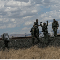 """Memes, Marijuana, and Mexico: (AP Photo/Rodrigo Abd) U.S. BorderPatrol agents carry bales of marijuana they found along the highway near Ryan, Texas, about 20 miles from the US-Mexico border. One agent said: """"They (the smugglers) just leave it and come back another day. It's going to be sad when they come back for it."""" Drug interdiction is a core mission for the Border Patrol."""