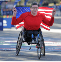 Daniel Romanchuk of the United States poses for a picture after crossing the finish line first in the men's wheelchair division of the New York City Marathon in New York.: AP Photo/Seth Wenig Daniel Romanchuk of the United States poses for a picture after crossing the finish line first in the men's wheelchair division of the New York City Marathon in New York.