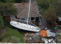 Memes, House, and Rain: AP Photo/Steve Helber A sailboat is shoved up against a house and a collapsed garage after heavy wind and rain from Florence ravaged New Bern, N.C.
