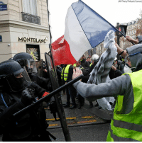 Police arrested nearly 1,000 protesters in Paris on Saturday after demonstrations calling for French President Emmanuel Macron's resignation turned violent.: (AP Photo/Thibault Camus)  UE  0  NC Police arrested nearly 1,000 protesters in Paris on Saturday after demonstrations calling for French President Emmanuel Macron's resignation turned violent.