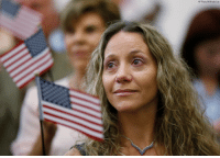 New American citizens wave flags during a naturalization ceremony at the U.S. Citizenship and Immigration Services Miami Field Office on Friday. One hundred forty-two citizenship candidates from 33 countries took the Oath of Allegiance.: AP Photo/Wilfredo Lee New American citizens wave flags during a naturalization ceremony at the U.S. Citizenship and Immigration Services Miami Field Office on Friday. One hundred forty-two citizenship candidates from 33 countries took the Oath of Allegiance.