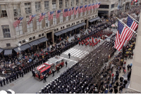 The casket of New York City firefighter Lieutenant Michael Davidson is carried on a firetruck down Fifth Avenue as it leaves St. Patrick's Cathedral after his funeral.: AP/Richard The casket of New York City firefighter Lieutenant Michael Davidson is carried on a firetruck down Fifth Avenue as it leaves St. Patrick's Cathedral after his funeral.
