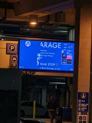 Meanwhile at Austin Bergstrom Intl': ARAGE  ApP T  ide) RT  axi  o By t  levators  AL  RAwe  ental Car Facility  ide App Pickup  Uber  Pxi  espasios  wingz  RAM STOPO  rel 2  o Blue Garage on Lev  Wa  A TAXI  RIDE APP  PICKUP  RENTAL  CAR  Ube Meanwhile at Austin Bergstrom Intl'