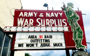 Local Army Surplus: ARMY & NAVY  WAR SURPLUS  AREA 51 RAID  OUTFITTING  WE WON'T JUDGE. MUCH Local Army Surplus