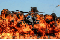Community, Fire, and Memes: arNationalGuirectobyTechEeesEeeringo) A USArmy AH-64D Apache Attack Helicopter flew in front of a wall of fire during the South Carolina National Guard Air and Ground Expo. South Carolina National Guard Airmen and Soldiers were able to demonstrate their skills and thank the community for their support.