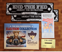 man card: ARREST THE BANKSTERS  L00001776 G  L00001776 G  INFOWARS.COM  CITIZENS  RULE BOOK  ARREST THE BANK  L00001776 G  INFO WARS COM  THE 2016 PRESIDENTIAL X  ELECTION COLLECTION  BILL OF RIGHTS  JURY HANDBOOK  The Fireworks are  READ THE CO  OF  BEN  TRU MP  MAKE AMERICA GREAT AGAIN  GARRISON  Grrr Graphics.com  A SUPERHUMAN EFEORT  2016  0005255