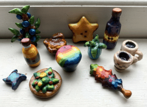 As a gift to my bf I made a bunch of his favorite things out of clay then painted them and I think they turned out pretty cute 😊: As a gift to my bf I made a bunch of his favorite things out of clay then painted them and I think they turned out pretty cute 😊
