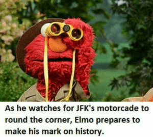 As He Watches for JFK's Motorcade to Round the Corner Elmo