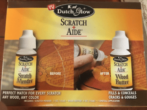 Match, Scratch, and Dutch Language: AS SEEN O  Dutch GHow  SCRATCH  1  AIDE  Dutch Clow  Dutch Glow  SCRATCH  SCRATCH  AIDE  Suateh  AIDE  Wood  BEFORE  AFTER  Butter  5 oz (15ml)  PERFECT MATCH FOR EVERY SCRATCH  ANY WOOD, ANY COLOR  FILLS & CONCEALS  CRACKS & GOUGES  INCLUDES: SCRATCH MENDER .5 OZ (15ml) ·WOOD BUTTER .5 OZ (15ml) . 1 SPATULA APPLICATOR Fix your scratches easily by placing a bottle in front of them!
