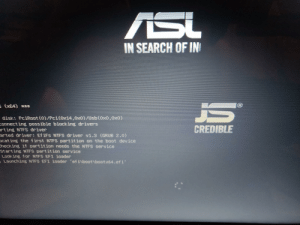 "Windows, Laptop, and Search: ASi  IN SEARCH OF IN  (x64) *  disk: PciRoot (0)/Pci(0x14,0x0)/Usb(0x0,0x0)  onnecting possible blocking drivers  arting MTFS driver  arted driver: EfiFs NTFS driver vi,3 (GRUB 2.0)  cating the first NTFS partition on the boot device  hecking if partition needs the NTFS service  Starting NTFS partition service  Looking for NTFS EFI loader  Launching NTFS EFI loader 'ef iboot boot x64. efi'  CREDIBLE Windows setup on ""asl js"" laptop"