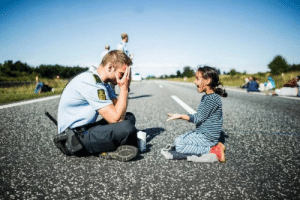 """aspiretostudy:  newjork:  aspiretostudy:  Have everyone seen this picture of the Danish cop playing games with a little Syrian refrugee on her way to Sweden?  ok? and?  This child has suffered in a country filled with terror, managed to escape and then walked and traveled her way from one continent to another. This is a child in the mids of terror and hatred. Her people have been kicked and spit at. She is a child who have not been allowed to be a child. She is a victim of a war she can't controll. And then she arrives at the other side of the world, and someone finally treats her like a child. Who see her and play with her and give her some comic relief in the mids of the most traumatic experince of her life, in a country where no one speaks her language and it is so much colder than what she has known. In the mids of war and terror we forget that kids are still kids, and this police officer on the other side of the world  reminds us that they are indeed children. Don't come here and """"and?"""" me! : aspiretostudy:  newjork:  aspiretostudy:  Have everyone seen this picture of the Danish cop playing games with a little Syrian refrugee on her way to Sweden?  ok? and?  This child has suffered in a country filled with terror, managed to escape and then walked and traveled her way from one continent to another. This is a child in the mids of terror and hatred. Her people have been kicked and spit at. She is a child who have not been allowed to be a child. She is a victim of a war she can't controll. And then she arrives at the other side of the world, and someone finally treats her like a child. Who see her and play with her and give her some comic relief in the mids of the most traumatic experince of her life, in a country where no one speaks her language and it is so much colder than what she has known. In the mids of war and terror we forget that kids are still kids, and this police officer on the other side of the world  reminds us that they are indeed children. Don't c"""