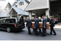 Memes, Charlotte, and Today: ASSOCATEO PRESS Earlier today, pallbearers carried the body of Rev. Billy Graham into a hearse before leaving the Billy Graham Training Center in Asheville, N.C. Graham's body is being brought to his hometown of Charlotte as part of a procession.