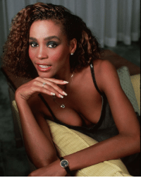 Memes, Whitney Houston, and Sang: At the age of 11, Whitney Houston started performing as a soloist in the junior gospel choir at the New Hope Baptist Church in Newark, where she also learned to play the piano. . She spent some of her teenage years touring nightclubs where her mother Cissy, a gospel singer, was performing, and she would occasionally get on stage and perform with her. . In 1977, at age 14, she became a backup singer on the Michael Zager Band's single Life's a Party. . The following year, at age 15, Houston sang background vocals for Chaka Khan and Lou Rawls. . In the early 1980s, Whitney started working as a fashion model after a photographer saw her at Carnegie Hall singing with her mother. She appeared in Seventeen and became one of the first women of color to grace the cover of the magazine. . She was also featured in layouts in the pages of Glamour, Cosmopolitan, Young Miss, and appeared in a Canada Dry soft drink TV commercial. . Whitney had previously been offered several recording agencies (Michael Zager in 1980, and Elektra Records in 1981), but her mother declined the offers stating her daughter must first complete high school. . In 1983, Gerry Griffith, an A&R representative from Arista Records, saw her performing with her mother in a New York City nightclub and was impressed. He convinced Arista's head Clive Davis to make time to see Whitney perform. . Clive Davis was impressed and immediately offered a worldwide recording contract which Houston signed. Later that year, she made her national televised debut alongside Davis on The Merv Griffin Show. . Her debut album, Whitney Houston (1985), became the best-selling debut album by a woman in history. . She went on to become one of pop music's best-selling music artists of all-time, with an estimated 170–200 million records sold worldwide. . She released seven studio albums and two soundtrack albums, all of which have diamond, multi-platinum, platinum or gold certification. . RIP, Whitney Houston. Today marks five years since her passing. . JerseyStandup BlackHistory BlackExcellence excellence