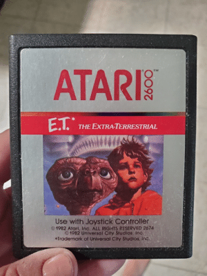 Parents, House, and E.T.: ATARI  TM  E.T.  THE EXTRA-TERRESTRIAL  Use with Joystick Controller  1982 Atari, Inc. ALL RIGHTS RESERVED 2674  1982 Universal City Studios, Inc.  *Trademark of Universal City Studios, inc Cleaning out my parents house and found this gem
