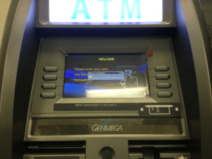 Windows, Headphones, and Ip Address: ATM  WELCOME  Please push your card  OK X  Windows CE Networking  into the s  Your IP address lease has expired. DHCP was unable  to renew your lease.  transaction  INSERT HEADPHONES TO USE SPEECH  GENMEGA  0470  mith This ATM runs windows