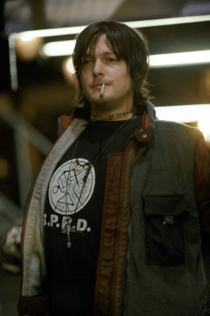 In Blade II the character of Norman Reedus (Scud) wears a B.P.R.D. T-Shirt (Bureau for Paranormal Research and Defense). Del Toro directed this film in 2002 and Hellboy in 2004, and he is a Mignola's big fan.: AVE  3.P.R.D. In Blade II the character of Norman Reedus (Scud) wears a B.P.R.D. T-Shirt (Bureau for Paranormal Research and Defense). Del Toro directed this film in 2002 and Hellboy in 2004, and he is a Mignola's big fan.