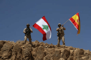 Barcelona, Isis, and Spanish: Awesome Lebanese army raises Spanish flag on captured ISIS hilltop - paying homage to Barcelona attack victims