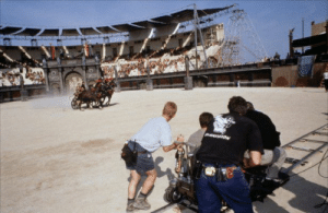 """Gladiator, Movie, and Jeans: b  ma es If you look closely in this scene from """"Gladiator"""", you'll see a cameraman in jeans in the bottom right corner of the screen. This is in reference to the fact that after the movie the behind the scenes features played automatically."""