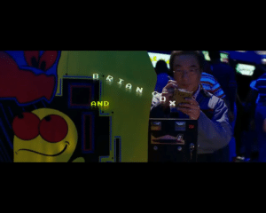 PIXELS (2015) - In the opening arcade scene, the real Toru Iwatani can be scene repairing a 'Pac-Man' arcade machine.: B RIAN  AND  25 PIXELS (2015) - In the opening arcade scene, the real Toru Iwatani can be scene repairing a 'Pac-Man' arcade machine.