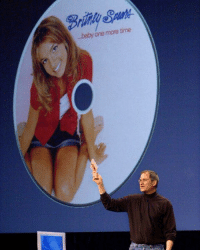"Apple, Britney Spears, and Memes: ..baby one more time today in history: Apple CEO Steve Jobs holding Britney Spears' ""...Baby One More Time"" at a developer conference."