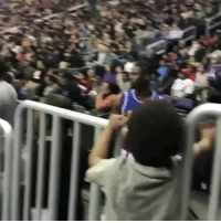 Basketball, Slow Motion, and Perfect Loop Gif: Basketball player giving kid a slow motion high five.