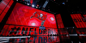 A @MakeAWish dream come true.  Battling Hodgkin's Lymphoma, 19-year-old Kacey Reynolds will announce the @Buccaneers' first pick in the 2019 @NFLDraft: https://t.co/OodiNOnBd9 https://t.co/r3HQbPlLNQ: BAY  HE CLOR  EA  THE LOCK VHTHE  DRAFT  NEIGARN A @MakeAWish dream come true.  Battling Hodgkin's Lymphoma, 19-year-old Kacey Reynolds will announce the @Buccaneers' first pick in the 2019 @NFLDraft: https://t.co/OodiNOnBd9 https://t.co/r3HQbPlLNQ