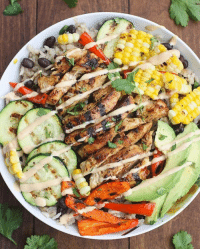 Fresh, Memes, and Avocado: BBQ Ranch Grilled Chicken and Veggie Bowls Made by @tastesbetterfromscratch . Yield: Serves 4 Ingredients For the chicken and veggies: 2 boneless, skinless chicken breasts 1 (16 oz) bottle Hidden Valley® Honey BBQ Ranch® Dressing 1 zucchini, washed and sliced into 1-4'' thick rounds 1 red bell pepper, washed, seeded and sliced 4 ears of grilled corn on the cob (or substitute 1 1-2 cups cooked corn) 1 avocado, peeled, seeded and sliced Fresh cilantro, for garnish, if desired For the rice: 2 tablespoons vegetable oil 1-2 cup chopped onion 1 1-2 cups long grain white rice 1 teaspoon ground cumin 3 cups chicken broth 1 can black beans, washed and drained Instructions For the rice: Add oil to a saucepan over medium heat. Add chopped onion and rice and saute, stirring frequently, for 3-5 minutes or until rice begins to get golden brown. Add cumin, chicken broth and black beans. Bring to a boil, reduce heat to low, cover and cook for 20 minutes. Remove from heat and allow to rest for 5 minutes. Remove lid and fluff gently with a fork. Set aside. For the chicken and veggies. Meanwhile, place chicken in a shallow dish and baste with 1 heaping cup of Hidden Valley Honey BBQ Ranch Dressing. Refrigerate for at least 20 minutes. To grill the zucchini and bell peppers you can use a grill basket and cook them over medium heat on the grill, or use a grill pan on the stove or on the grill pan on the stove. After the veggies are cooked, add the marinated chicken to the grill over medium heat. Cook for several minutes, flipping once, until cooked through. Remove to a plate to rest for 5 minutes before cutting. Spoon cooked rice into bowls. Top with chopped, cooked chicken, grilled zucchini, bell peppers, corn and sliced avocado. Drizzle Honey BBQ Ranch Sauce on top. Garnish with fresh cilantro, if desired.