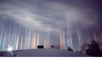 "Memes, Cry-Baby, and Phenomenon: Because of his crying baby, a father was able to photograph this amazing ""light pillars"" phenomenon. When northern Ontario's Timothy Joseph Elzinga woke up at one thirty in the morning to soothe his young son, he got much more than just a crying baby. What he got was to experience a very rare phenomenon: ""light pillars."" Light pillars occur when either natural or artificial light bounces off ice crystals floating close to the ground. In Elzinga's case, the air was so cold that ice crystals were forming in the air, reflecting the city's street and business lights. Joked Elzinga about witnessing such an amazing sight, ""We can blame the two year old."" Shout-out to our friends @News for the story! Photo cred:Timothy Joseph Elzinga"