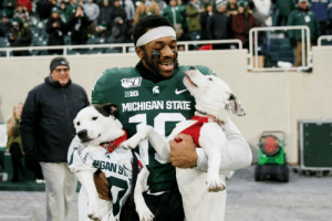 College, Dogs, and Parents: BIG  MICHIGAN STATE  GAN ST Michigan State senior cornerback Josh Butler brought his dogs, Roxy and Remi, into Spartan Stadium as he was introduced before the game against Maryland. Butler lost both parents during his college tenure and he chose to walk with his dogs on senior day.